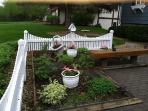 This simple entry garden is welcoming even in early spring.