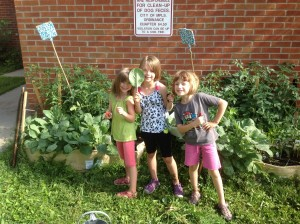 Enthusiastic young gardeners enjoying the fruits of their labor.