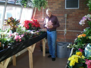 Norm Wente in the conservatory at Colonial Acres
