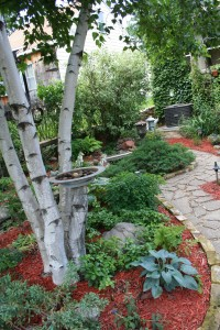 Bark and garden art offer other ways to add white to the garden.