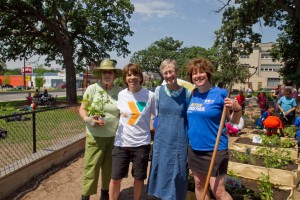 Volunteers from the Twin Cities Corporate Garden Giving Network help plant a community garden at the Midway YMCA in St. Paul.