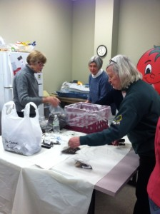 Volunteers packing bulbs for sale at the home shows.