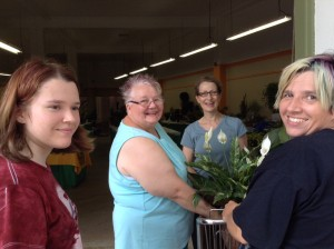 Vicky Vogels (rear) assists Kyra, Linda and Jenny as they register for the plant show.