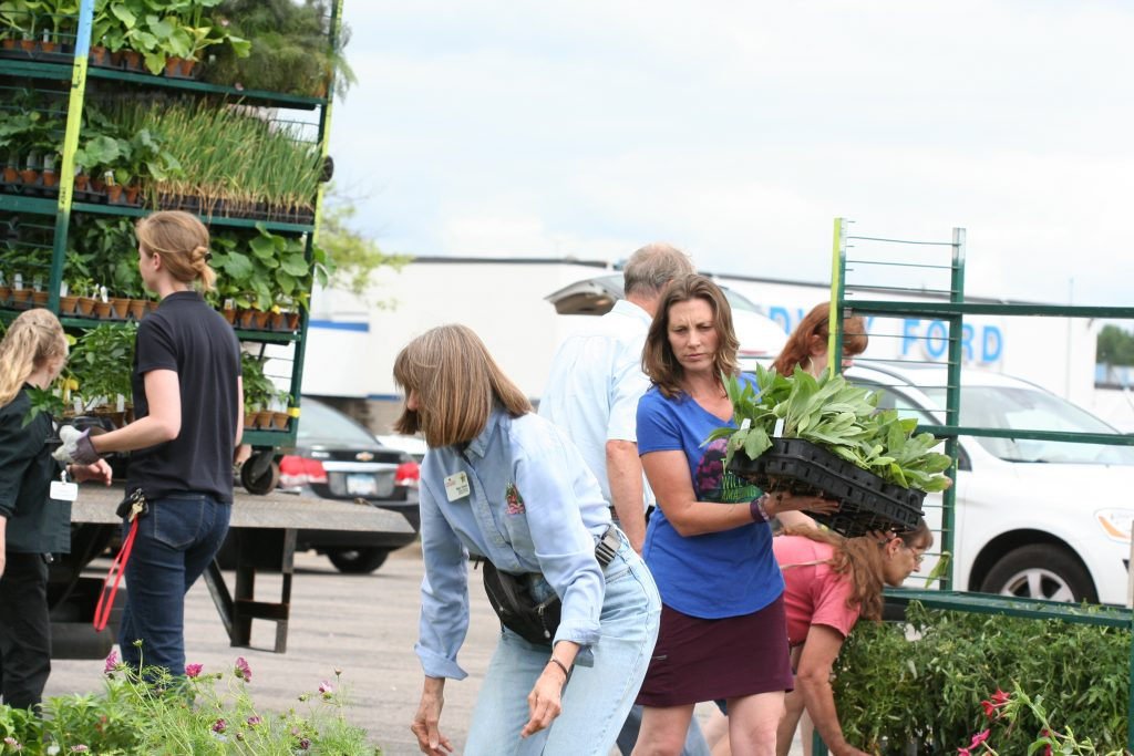 Community gardeners unload another truck of donations to Minnesota Green.