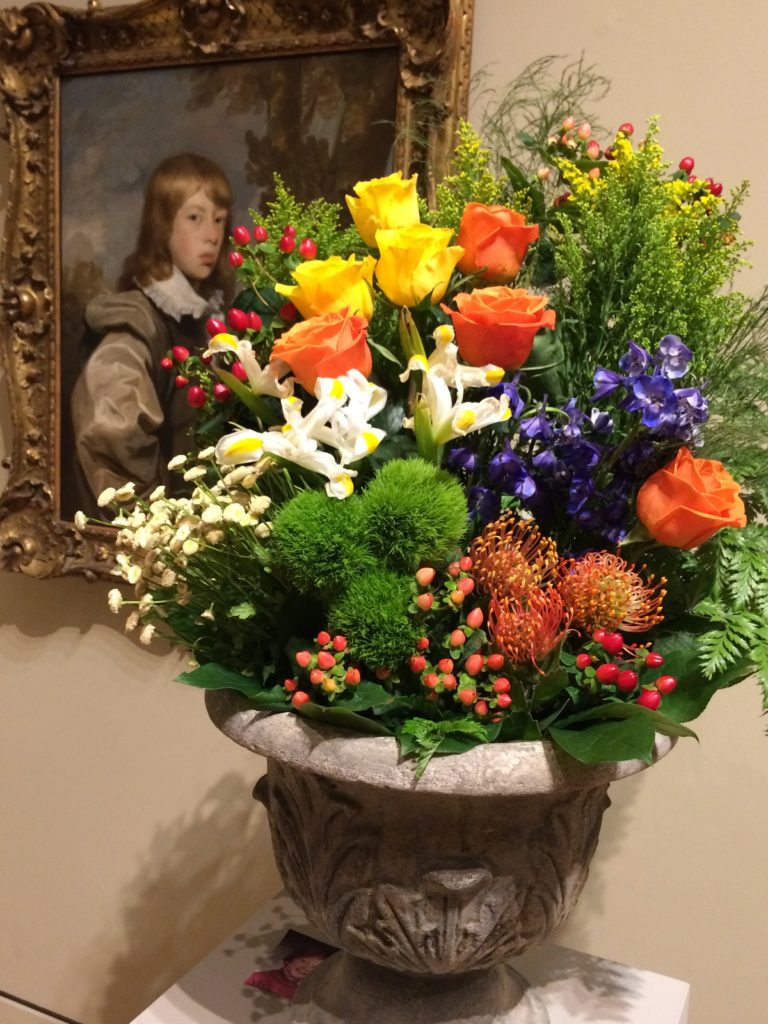 floral display interpreting portrait of young man at art in bloom