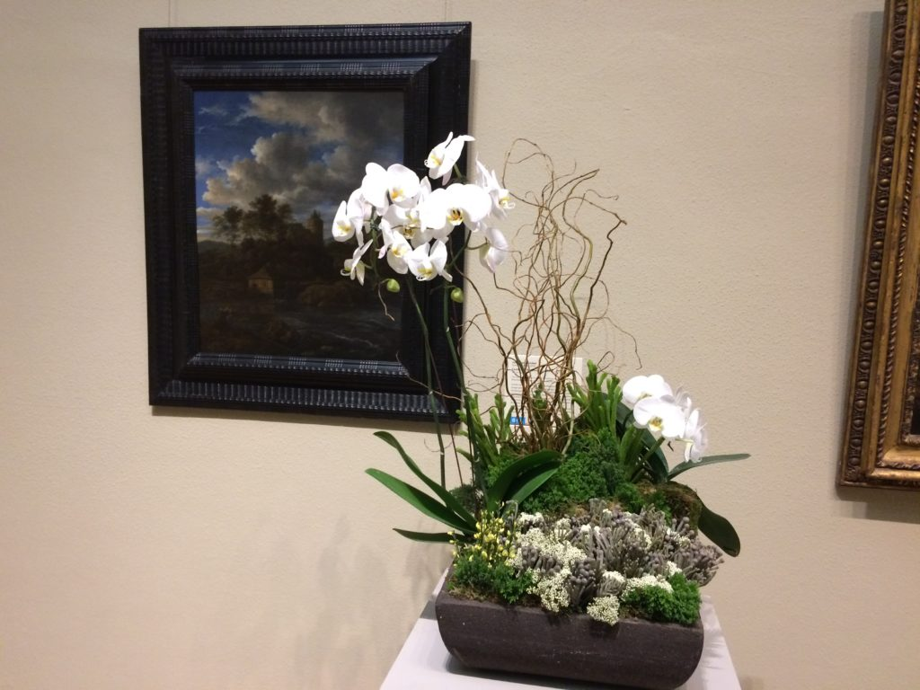 orchid flower arrangement and landscape painting