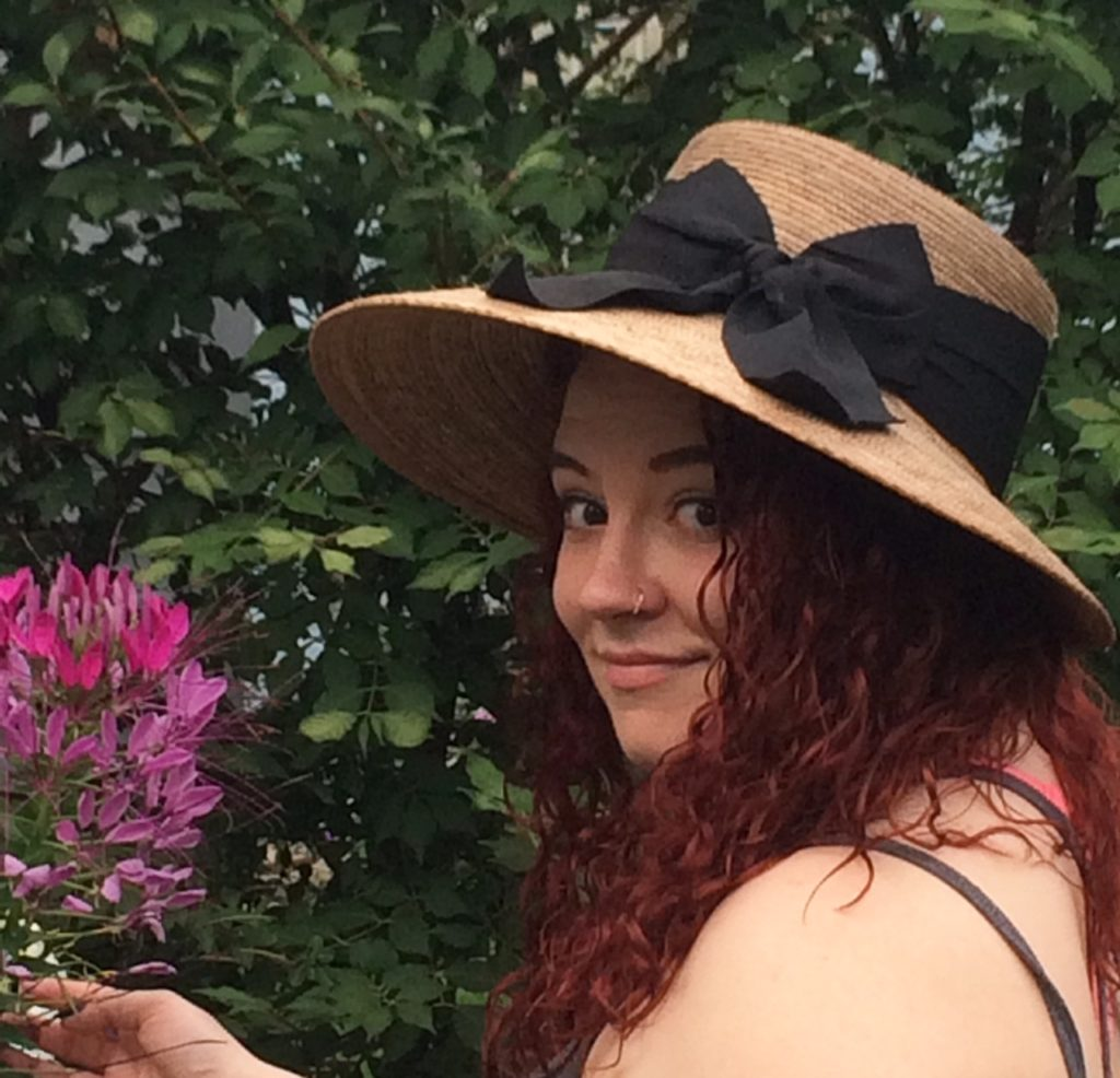 young woman wearing garden hat