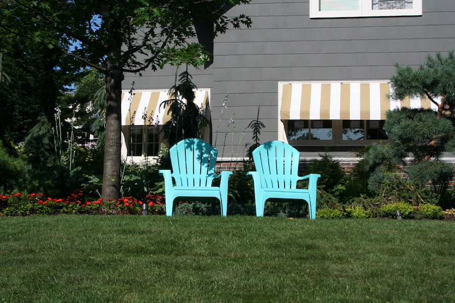two chairs in front yard