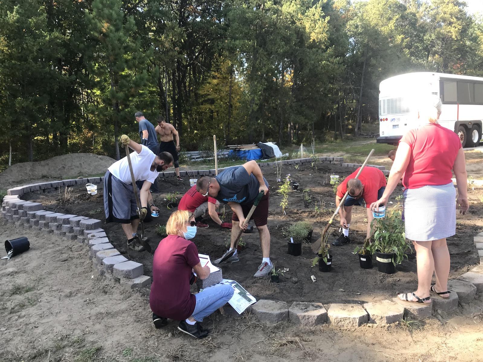 gardeners planting a monarch waystation