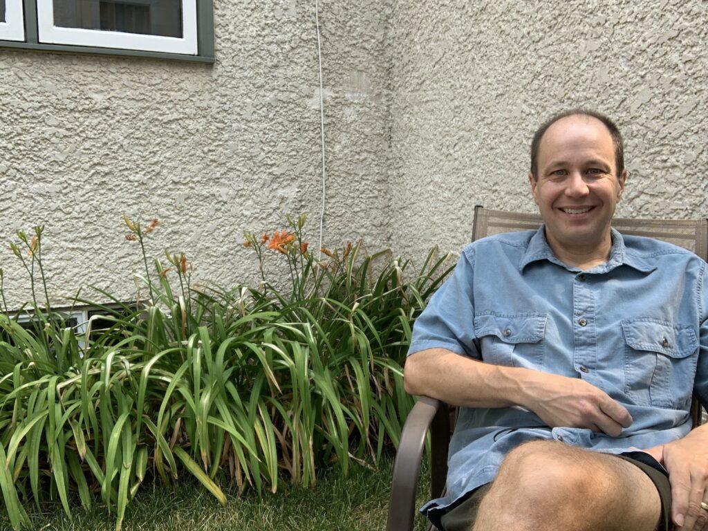 MSHS volunteer sitting in garden