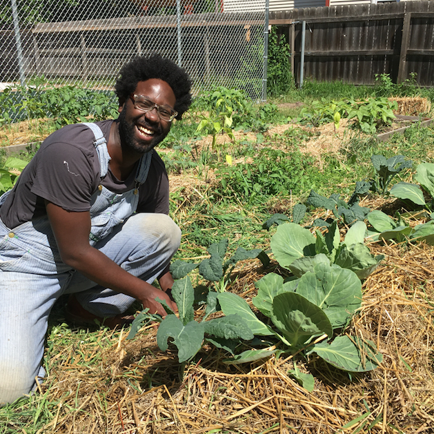 Eric, one of the Peaceful Grounds volunteers, works in the vegetable garden.